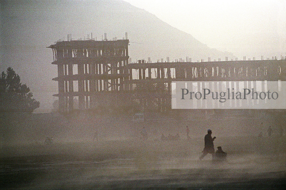A dusty afternoon. In rhe backgrong a five-floor building under construction