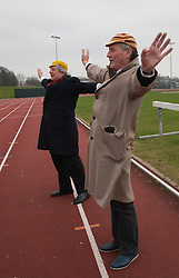 "© Licensed to London News Pictures. 03/03/2012. London, England. L-R: Terry Jones and Michael Palin doing warming up exercises. Terry Jones and Michael Palin of Monty Pythons fame today, Saturday 3 March, staged a public ""Hopathon"" to mark the DVD release of Ripping Yarns The Complete Series, and as an homage to the episode entitled Tomkinson's School Days at the Athletics Track in  Hampstead Heath, London. Photo credit: Bettina Strenske/LNP"