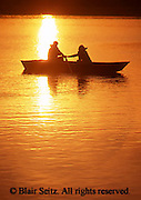 Active Aging Senior Citizens, Retired, Activities, Elderly Couple Outdoor Recreation, Staying Fit, Enjoying Nature, Boating on Lake, Sunset, Romantic Couple