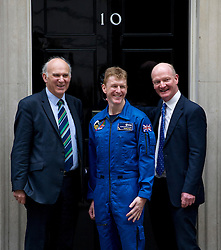 © London News Pictures. 20/05/2013 . London, UK.  Major TIM PEAKE (centre), who is to become the first UK astronaut to visit the International Space Station (ISS),  posing for photographers with Business Secretary VINCE CABLE MP (Left) and Science minister DAVID WILLETTS  (right), as he enters 10 Downing Street in London to meet British Prime Minister David Cameron. Major Peake will become the first British astronaut in 20 years Photo credit : Ben Cawthra/LNP