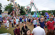 A crowd walks through Southampton Days Carnival as part of their July 4th celebration Saturday July 4, 2015 in Upper Southampton, Pennsylvania. (Photo by William Thomas Cain)