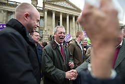 © Licensed to London News Pictures . 25/05/2016 . Bolton , UK . NIGEL FARAGE surrounded by supporters and media in front of Bolton Town Hall . The UKIP referendum bus tour , campaigning for a UK Brexit , lead by Nigel Farage , in Victoria Square , Bolton . Photo credit : Joel Goodman/LNP