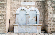 Israel, renovated old city of Jaffa now an artist's colony. Marble drinking water fountain