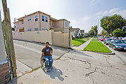 Felipe Adams, a 30-year-old Iraq war veteran who was paralyzed by a sniper's bullet in Baghdad, Iraq in his wheelchair outside his home in Inglewood, California. (Felipe Adams is featured in the book What I Eat: Around the World in 80 Diets.) MODEL RELEASED.