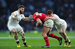 Jonathan Davies of Wales is tackled by Jack Clifford of England - Mandatory byline: Patrick Khachfe/JMP - 07966 386802 - 12/03/2016 - RUGBY UNION - Twickenham Stadium - London, England - England v Wales - RBS Six Nations.