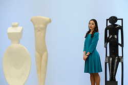 "© Licensed to London News Pictures. 08/05/2017. London, UK. A staff member stands with (L to R) ""Woman with her Throat Cut"", 1932; ""Walking Woman (I)"", 1932 and ""Spoon Woman"", 1927.  Preview of the UK's first major retrospective of Alberto Giacometti for 20 years at Tate Modern.  The exhibition runs 10 May to 10 September 2017. Photo credit : Stephen Chung/LNP"