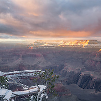 Bright afternoon sun on the snowy cliffs of the Grand Canyon. Yavapai Point Overlook.