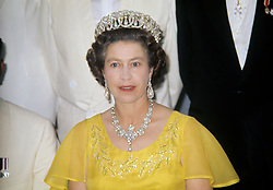 Queen Elizabeth II on board the Royal yacht Britannia during a dinner party for the West Indies Associated States, during her Silver Jubilee tour of the Caribbean.