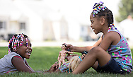 7/20/2016: Zyiana Hudson, left, andMi&rsquo;lana Beathea, both 6, play with dolls in the shade at their grandmother&rsquo;s house in South Bend on Tuesday. Tribune Photo/SANTIAGO FLORES<br /> <br /> Zyiana Hudson, 6, (LEFT) and Mi'lana Beathea, 6, play with their dolls in the shade at their grandmother's house in South Bend on Tuesday July 19, 2016. Tribune Photo/SANTIAGO FLORES