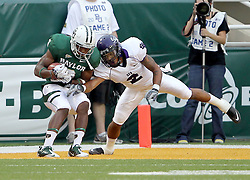 Baylor wide receiver Lanear Sampson (3) holds on to a touchdown pass as  Stephen F. Austin defensive back Ben Wells (2) defends during an NCAA college football game, Saturday, Sept. 17, 2011, in Waco, Texas. Baylor won 48-0.