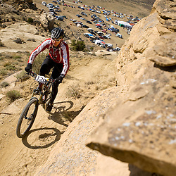 Eric Ivie climbs the switchbacks on third mesa. Ivie rode 5 laps for the day.