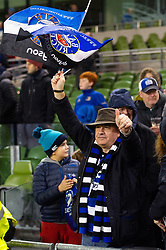 A Bath Rugby fan in the crowd waves a flag in support after the match - Mandatory byline: Patrick Khachfe/JMP - 07966 386802 - 15/12/2018 - RUGBY UNION - Aviva Stadium - Dublin, Republic of Ireland - Leinster Rugby v Bath Rugby - Heineken Champions Cup