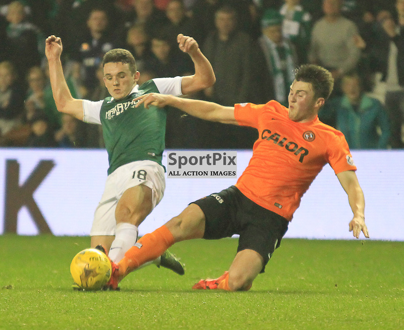Hibernian V Dundee United Scottish League Cup Quarter Final 4th November 2015; Hibernian's Liam Henderson is tackled by Dundee United's John Souttar during the Hibernian V Dundee United League Cup Quarter Final tie, played at Easter Road Stadium, Edinburgh.