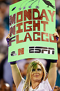 A female Baltimore Ravens fan holds up a sign for Monday Night Football and Ravens quarterback Joe Flacco (5) during the NFL week 7 football game against the Jacksonville Jaguars on Monday, October 24, 2011 in Jacksonville, Florida. The Jaguars won the game 12-7. ©Paul Anthony Spinelli