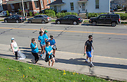 Volunteers look for litter to pick up along West State Street during Athens Beautification Day on April 17, 2016.