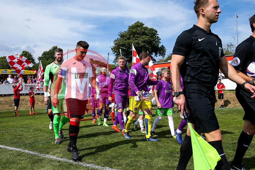 The teams make their way out - Rogan/JMP - 09/07/2017 - The Creek - Bristol, England - Bristol Manor Farm v Bristol City - Pre-season Friendly.