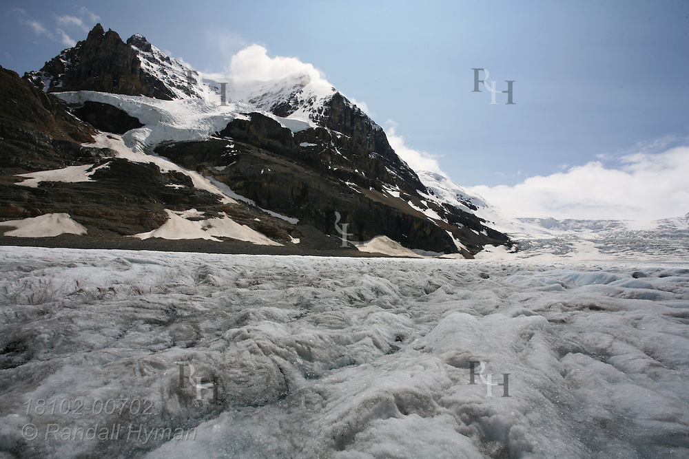 Vast river of ice, the Athabasca Glacier, overflows from Columbia Icefield between Mount Andromeda and Snow Dome in Jasper National Park, Alberta, Canada.