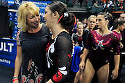University of Utah co-head coach Megan Marsden gives a pep-talk to junior Stephanie McAllister before her turn at the vault during the 2011 Women's NCAA Gymnastics Championship Individual Event Finals on April 17, in Cleveland, OH. McAllister tied for 13th place. (photo/Jason Miller)