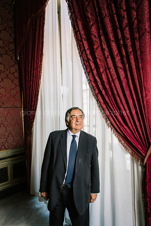 PALERMO, ITALY - 15 JUNE 2018: Mayor of Palermo Leoluca Orlando poses for a portrait in his office at Palazzo delle Aquile in Palermo, Italy, on June 15th 2018.<br /> <br /> Manifesta is the European Nomadic Biennial, held in a different host city every two years. It is a major international art event, attracting visitors from all over the world. Manifesta was founded in Amsterdam in the early 1990s as a European biennial of contemporary art striving to enhance artistic and cultural exchanges after the end of Cold War. In the next decade, Manifesta will focus on evolving from an art exhibition into an interdisciplinary platform for social change, introducing holistic urban research and legacy-oriented programming as the core of its model.<br /> Manifesta is still run by its original founder, Dutch historian Hedwig Fijen, and managed by a permanent team of international specialists.<br /> <br /> The City of Palermo was important for Manifesta&rsquo;s selection board for its representation of two important themes that identify contemporary Europe: migration and climate change and how these issues impact our cities.