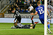 Anssi Jaakkola (32) of Bristol Rovers makes a save at the feet of Aaron Connolly (44) of Brighton and Hove Albion during the EFL Cup match between Bristol Rovers and Brighton and Hove Albion at the Memorial Stadium, Bristol, England on 27 August 2019.