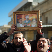 January 20, 2012 - Idleb, Syria: Protestors hold a picture of some revolution martyrs during a demonstrations anti-regime in central Taftanaz, Idleb.
