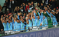 Vincent Kompany of Manchester City lifts the Carabao Cup with his teammates - Mandatory by-line: Matt McNulty/JMP - 25/02/2018 - FOOTBALL - Wembley Stadium - London, England - Arsenal v Manchester City - Carabao Cup Final