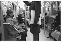 Headless man with large white envelope, New York City subway, Street photography. 1980
