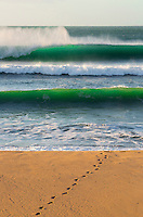 Footprints in the sand and offshore waves