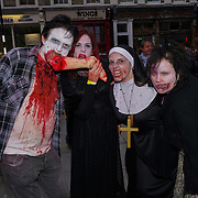 Freemosons hall , London, England, UK. 7th October 2017. Hundreds dress up as the zombies walking he dead in central London on World Zombie Day: London is to raise money for the homeless charity, St. Mungo's Broadway.