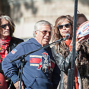 05 November 2012:  NE Patriots owner Robert Kraft presents Aerosmith's Steven Tyler with a custom game ball before Aerosmiths' free concert  in Allston.  Guitar player Joe Perry behind and left watches as thousands of fans filled Commonwealth Avenue to watch Aerosmith play in front of the building (No. 1325) where band members once lived.  Boston, MA. ***Editorial Use Only*****