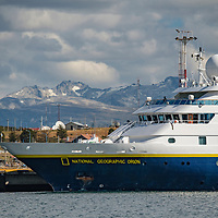 The National Geographic Orion ship docked in the harbor of the town of Ushuaia, known as the End of the World or Fin del Mundo, on the Beagle Channel in Argentina.