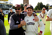 Somerset Director of Cricket Matt Maynard with Roelof van der Merwe of Somerset as they do a lap of honour after beating Middlesex to secure survival in Division 1 of the Specsavers County Champ Div 1 match between Somerset County Cricket Club and Middlesex County Cricket Club at the Cooper Associates County Ground, Taunton, United Kingdom on 28 September 2017. Photo by Graham Hunt.