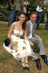 "GEORDIE GREIG and his wife KATHERINE at the Goodwood Festival of Speed on 9th July 2006.  Cartier sponsored the ""Style Et Luxe' for vintage cars on the final day of this annual event at Goodwood House, West Sussex and hosted a lunch.<br />