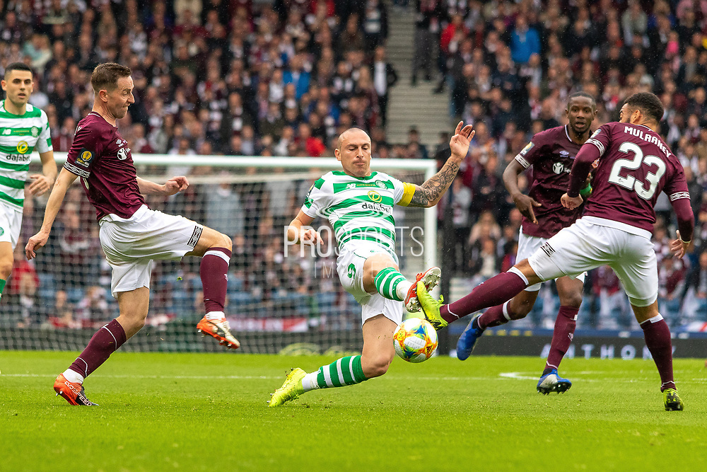 Celtic Captain Scott Brown stretches for the ball during the William Hill Scottish Cup Final match between Heart of Midlothian and Celtic at Hampden Park, Glasgow, United Kingdom on 25 May 2019.