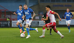 Marcus Maddison of Peterborough United in action with Terence Vancooten of Stevenage - Mandatory by-line: Joe Dent/JMP - 09/11/2019 - FOOTBALL - Lamex Stadium - Stevenage, England - Stevenage v Peterborough United - Emirates FA Cup first round