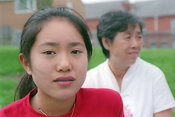 Young girl with her grandmother in background,
