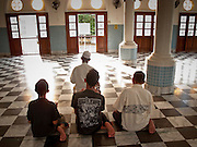 """Sept. 24, 2009 -- PATTANI, THAILAND: Men pray in the Central Mosque in Pattani, Thailand. Thailand's three southern most provinces; Yala, Pattani and Narathiwat are often called """"restive"""" and a decades long Muslim insurgency has gained traction recently. Nearly 4,000 people have been killed since 2004. The three southern provinces are under emergency control and there are more than 60,000 Thai military, police and paramilitary militia forces trying to keep the peace battling insurgents who favor car bombs and assassination.    Photo by Jack Kurtz / ZUMA Press"""