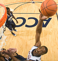 Virginia forward/center Jerome Meyinsse (55) shoots against Shepherd.  The Virginia Cavaliers defeated the Shepherd Rams 87-52 in an NCAA basketball exhibition game at the University of Virginia's John Paul Jones Arena in Charlottesville, VA on November 9, 2008.