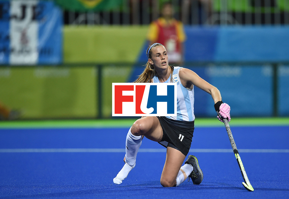 Argentina's Carla Rebecchi looks on after loosing her shoe during the women's field hockey Argentina vs USA match of the Rio 2016 Olympics Games at the Olympic Hockey Centre in Rio de Janeiro on August, 6 2016. / AFP / MANAN VATSYAYANA        (Photo credit should read MANAN VATSYAYANA/AFP/Getty Images)