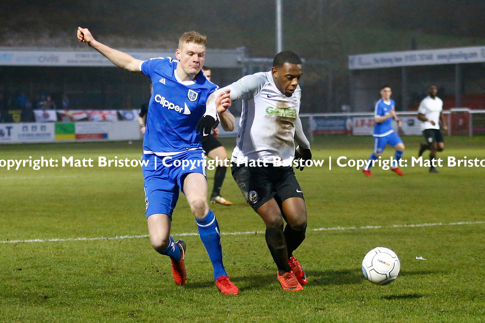 Dover's forward Anthony Jeffrey keeps Guiseleys defender Adam Crookes from the ball during the Vanorama National League match between Dover Athletic and Guiseley at Crabble Stadium, London, England on 27 January 2018. Photo by Matt Bristow.