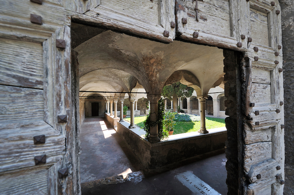 Gargnano, Lombardy, Italy. Through the old doorway into the 15thC Cloister of St. Francis in the town of Gargnano, Lake Garda.