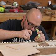 Mike Lentini works on a pipe organ at C.B. Fisk, Inc., Gloucester, MA