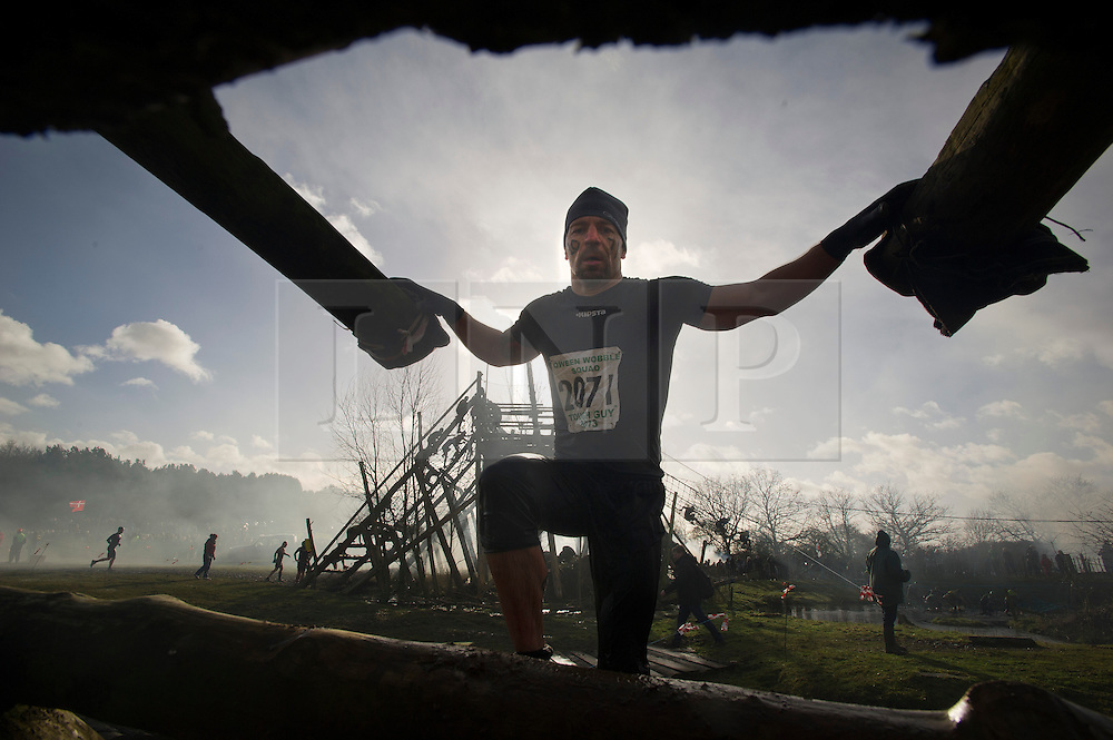 "©  London News Pictures. 27/01/2013.  Competitors being  pushed to the limits as they compete in the 2013 Tough Guy Challenge on January 27, 2013 in Wolverhampton, England. The event has been widely described as ""the toughest race in the world"", with up to one-third of the starters failing to finish in a typical year. Photo credit: Ben Cawthra"