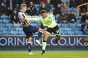 Millwall striker Steve Morison (20) grapples with Bournemouth Defender Tyrone Mings (26) during the The FA Cup 3rd round match between Millwall and Bournemouth at The Den, London, England on 7 January 2017. Photo by Matthew Redman.