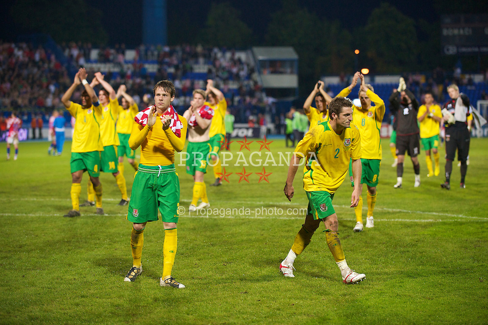 OSIJEK, CROATIA - Sunday, May 23, 2010: Wales' Chris Gunter and his team applaud the 48 travelling supporters after his side's 2-0 defeat by Croatia during the International Friendly match at the Stadion Gradski Vrt. (Pic by David Rawcliffe/Propaganda)
