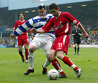 PHOTO: GERARD FARRELL<br /> QPR V STOCKPORT.<br /> NATIONWIDE DIVISION TWO.<br /> DATE: 17\04\2004.<br /> SWINDONS DAVID DUKE WITH THE BALL