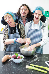 "© Licensed to London News Pictures . 15/05/2015 . Manchester , UK . Julie Hesmondhalgh and service user Andrew O'Sullivan (43 from Whalley Range) in the kitchen, watched over by Jay Raynor . Actress Julie Hesmondhalgh and food critic and broadcaster Jay Rayner join the first graduates from the ""Food for Life"" course at George House Trust . The project works with people in Manchester who are living with HIV to improve nutritional knowledge and cooking skills by delivering a practical hands-on short course . 'Food for Life' has been delivered by Manchester based HIV charity George House Trust, working in partnership with London based charity The Food Chain and supported by Manchester City Council . For more information see http://tinyurl.com/podjhqz .  Photo credit : Joel Goodman/LNP"