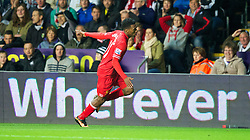 SWANSEA, WALES - Monday, September 16, 2013: Liverpool's Daniel Sturridge celebrates scoring the first equalising goal against Swansea City during the Premiership match at the Liberty Stadium. (Pic by David Rawcliffe/Propaganda)