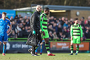 Forest Green Rovers Dale Bennett(2) is walked off the pitch by Forest Green Rovers physio Joe Baker during the EFL Sky Bet League 2 match between Forest Green Rovers and Notts County at the New Lawn, Forest Green, United Kingdom on 10 March 2018. Picture by Shane Healey.