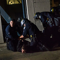 NOVEMBER 9, 2016 - OAKLAND, CA: Police make an arrest after Anti-Trump protesters take the streets to express their sentiments over the victory of Donald Trump in the 2016 Presidential Election, in Oakland, California on November 9, 2016. (Photo by Philip Pacheco)